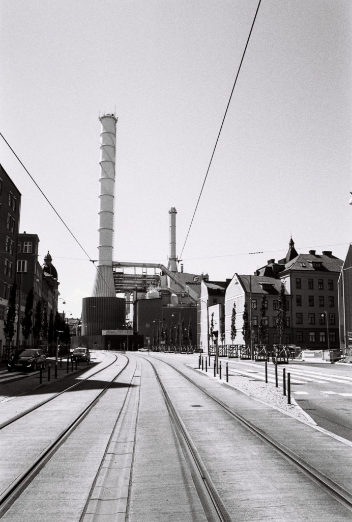 street in gothenborg with factory and chimney in background, black and white, analog camera