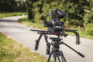 RED Epic camera 5k on a rig with a 28mm lens and monitors, street in the background